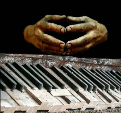 piano keys and hands
