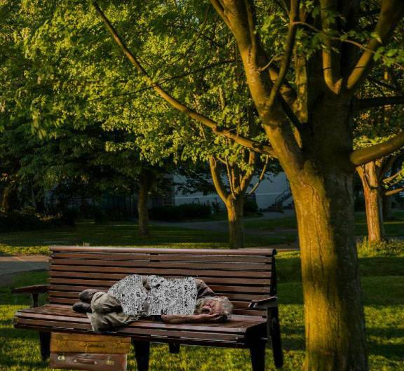 a man sleeping on bench done